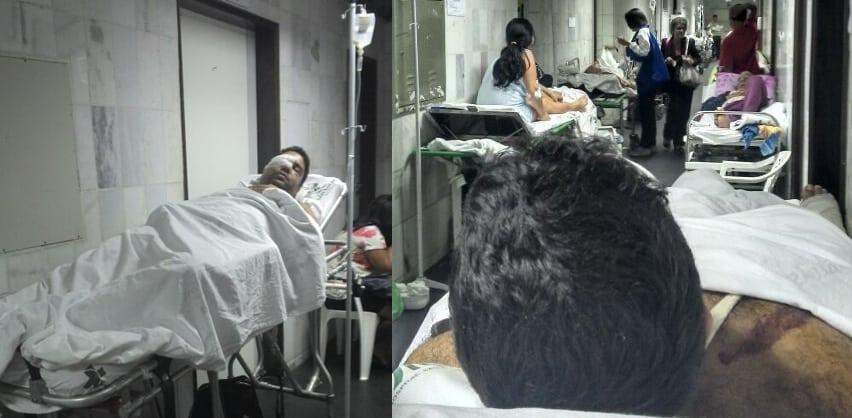 O jovem está em uma maca no corredor do Hospital. Os Familiares reclamam do estado caótico em que está o Hospital.