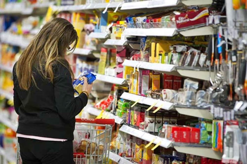 A shopper browses products at a Wesfarmers Ltd. Coles supermarket in Sydney, Australia, on Thursday, July 28, 2011. Wesfarmers Ltd., Australia's second-largest retailer, said fourth-quarter sales from its Coles supermarkets rose 7.2 percent as cheaper milk and bread lured customers. Photographer: Ian Waldie/Bloomberg
